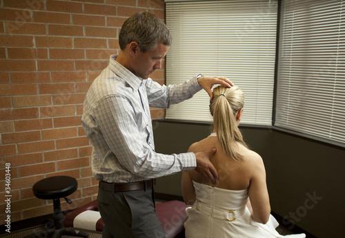 Cuadros en Lienzo chiropractor adjusting patient