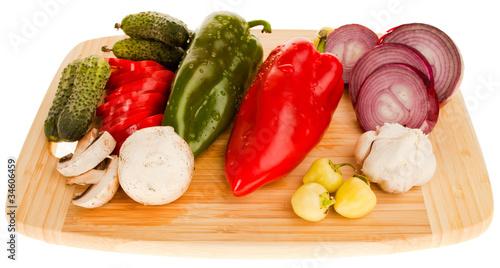 Fotobehang Groenten Fresh vegetabes on wooden board