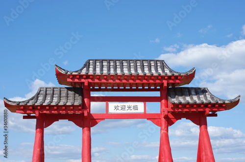 Garden Poster Temple Gate of Buddhist temple and blue sky with clouds