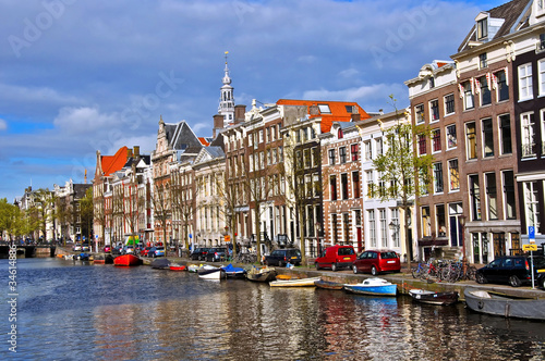 Photo  Classical Amsterdam view. Boat floats on the channel