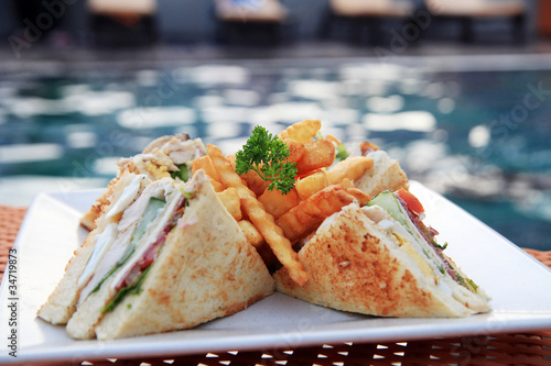 Canvas Prints Fish sandwich at pool outdoor