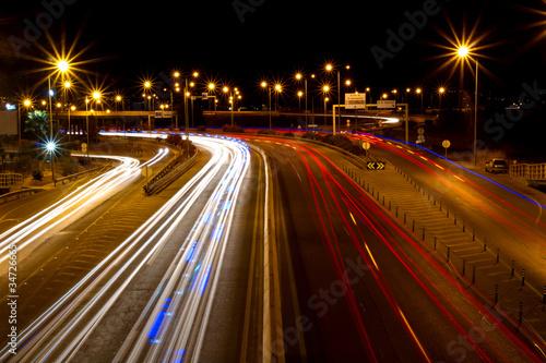 Foto op Aluminium Nacht snelweg intense trail lights