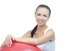 sensual smiling brunette with fitball after exercise isolated on
