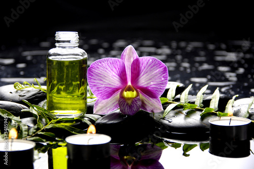Staande foto Spa Spa still life with massage oil and orchid