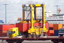 Container Straddle Carrier Is Lifting A Container