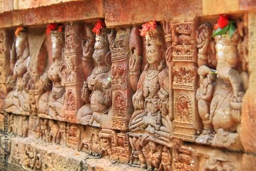 Fototapeta Religious bas-reliefs on a Hindu temple