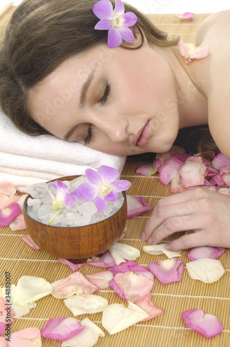 Poster Spa Spa resort girl in bowl of salt with orchid ,plants and towel