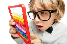 Young Boy With Abacus Toy Calc...