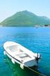 White sailboat at blue sea