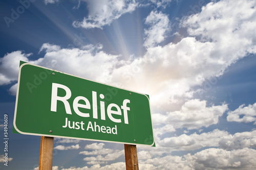 Fotografia  Relief Green Road Sign