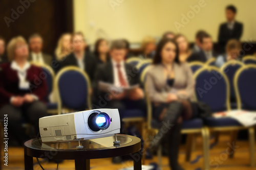 Fototapety, obrazy: Projector on background of blur sitting people