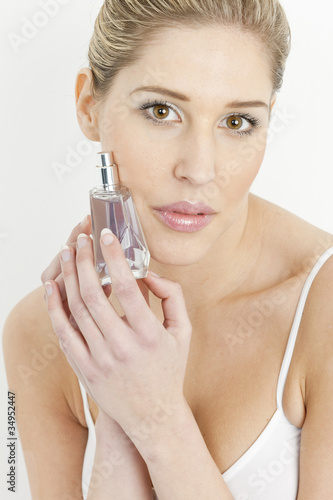 Fotografie, Obraz  portrait of young woman with perfume