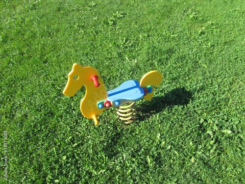 Poster Tuin Spielplatz - Schaukelpferd