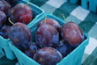 Fresh purple organic plums at a local Market