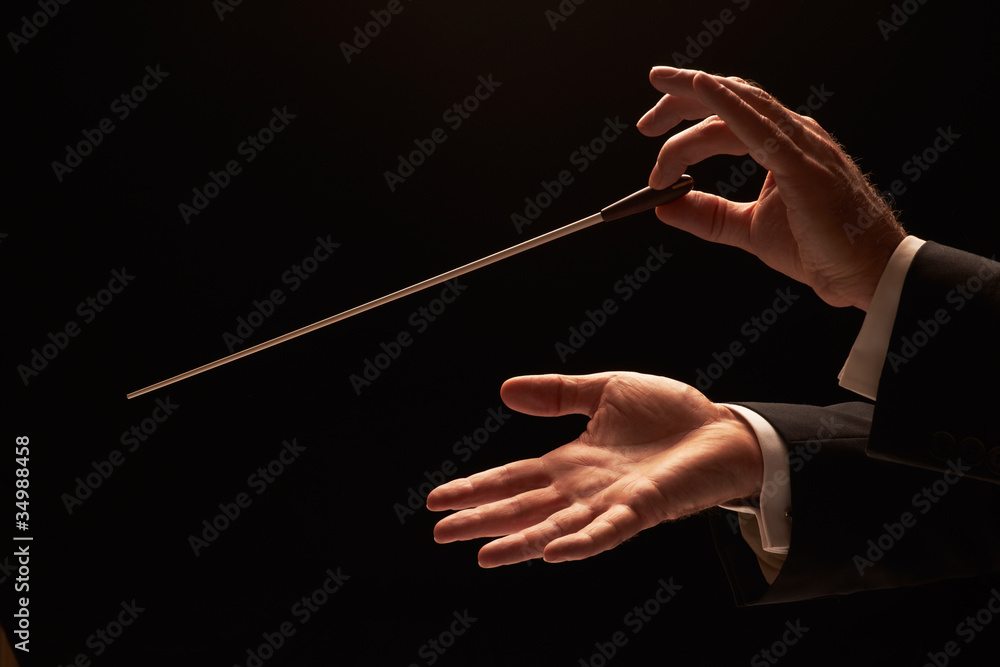 Photo Conductor conducting an orchestra