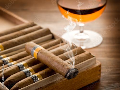 smoking cuban cigar and glass of  liquor on wood Slika na platnu