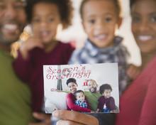 Black Family Holding Season's Greetings Photograph