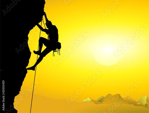 Fotografiet  Bergsteiger an einer Felswand