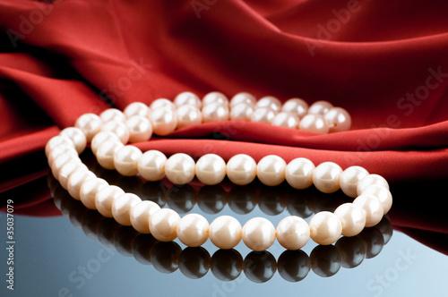 Fototapeta Pearls necklace on satin background