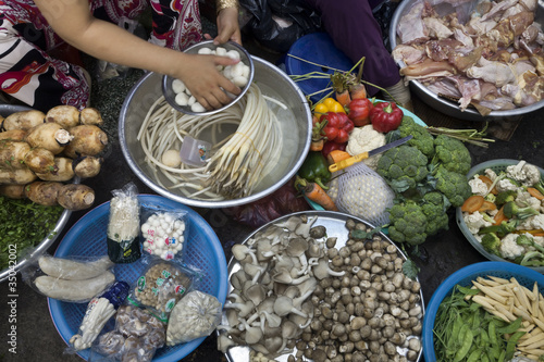 Vietnamese woman sitting with vegetables #35042002