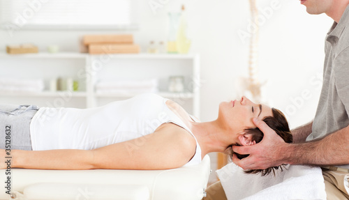 Chiropractor stretching a cute woman Canvas Print