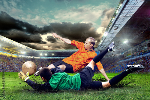 Tuinposter voetbal Football player on field of stadium