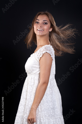 Fotografie, Obraz  beautiful girl with her ​​hair disheveled in the studio