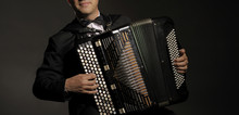 A Man Playing The Accordion