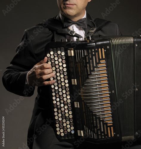 Fotografija  A man playing the accordion
