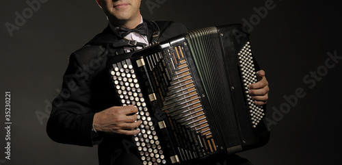 Fotografia, Obraz  A man playing the accordion
