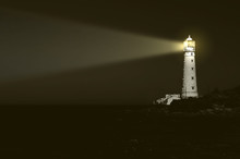 Lighthouse At Night: Beam Of Light Over Sea