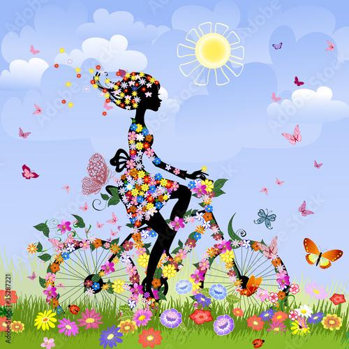 Fotobehang Bloemen vrouw Girl on bike outdoors in summer