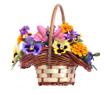 Basket Of Various Flowers On White Background