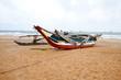 fishing boat on beach of negombo, sri lanka