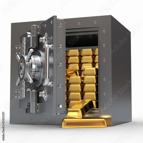 Fotografía  Stack of golden ingots in bank vault