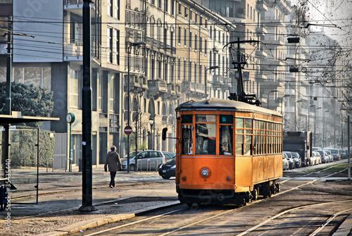 Poster Milan Old vintage orange tram on the street of Milan, Italy