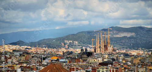 Papiers peints Barcelona panorama of barcelona, rain, cathedral sagrada familia, spain