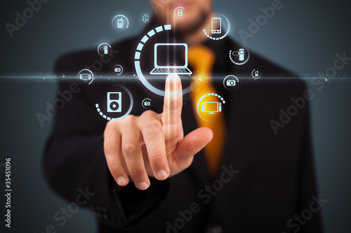 Fotografie, Obraz  Businessman pressing virtual media type of buttons