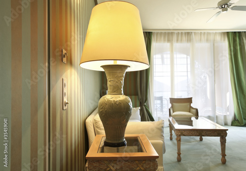 interior luxury apartment, comfortable suit, closeup table lamp