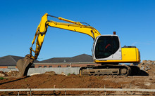 Yellow Excavator On A Construc...