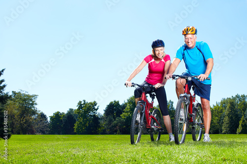 Photo Stands Cycling Riding couple.