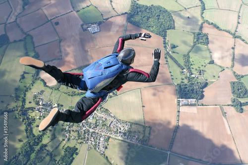 Obraz na płótnie Skydiver in freefall high up in the air