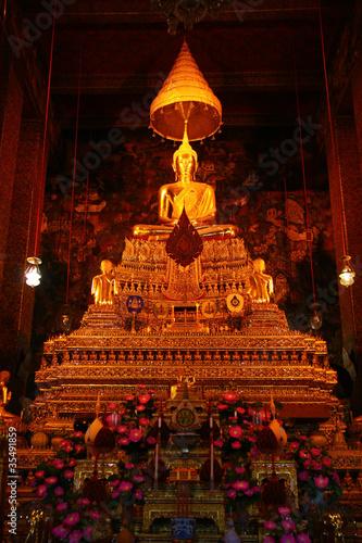 Tuinposter Boeddha Buddha Statues in church of Wat Pho, Bangkok, Thailand