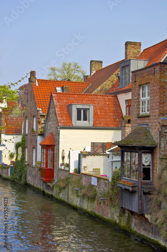Classic view of channels of Bruges. Belgium. Canvas Print