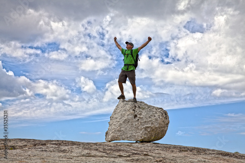 Fotomural  Rock climber celebrates on the summit.