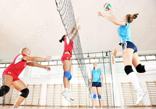 girls playing volleyball indoor game - 35527012