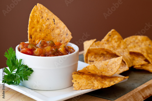 Fotografie, Obraz  Peach Mango Salsa with chipotle Chips