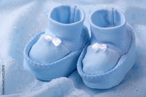 22eb5e22d454 Blue baby booties on blue background - Buy this stock photo and ...
