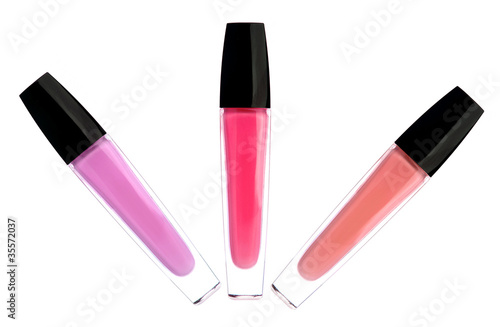 Fotografering  lipsticks (lipgloss) of pink color isolated on white background