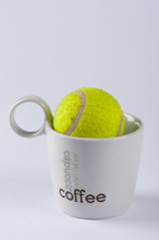 A Tennis Ball In A Cup Of Coffee #1